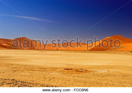 View across a dry river bed in the Wadi Mathendous on the